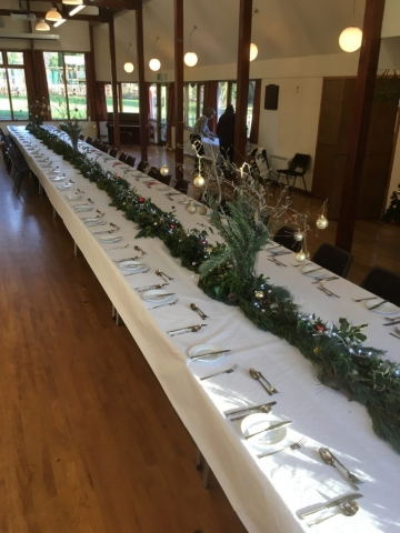 Several tables set up and dressed for the Christmas Meal