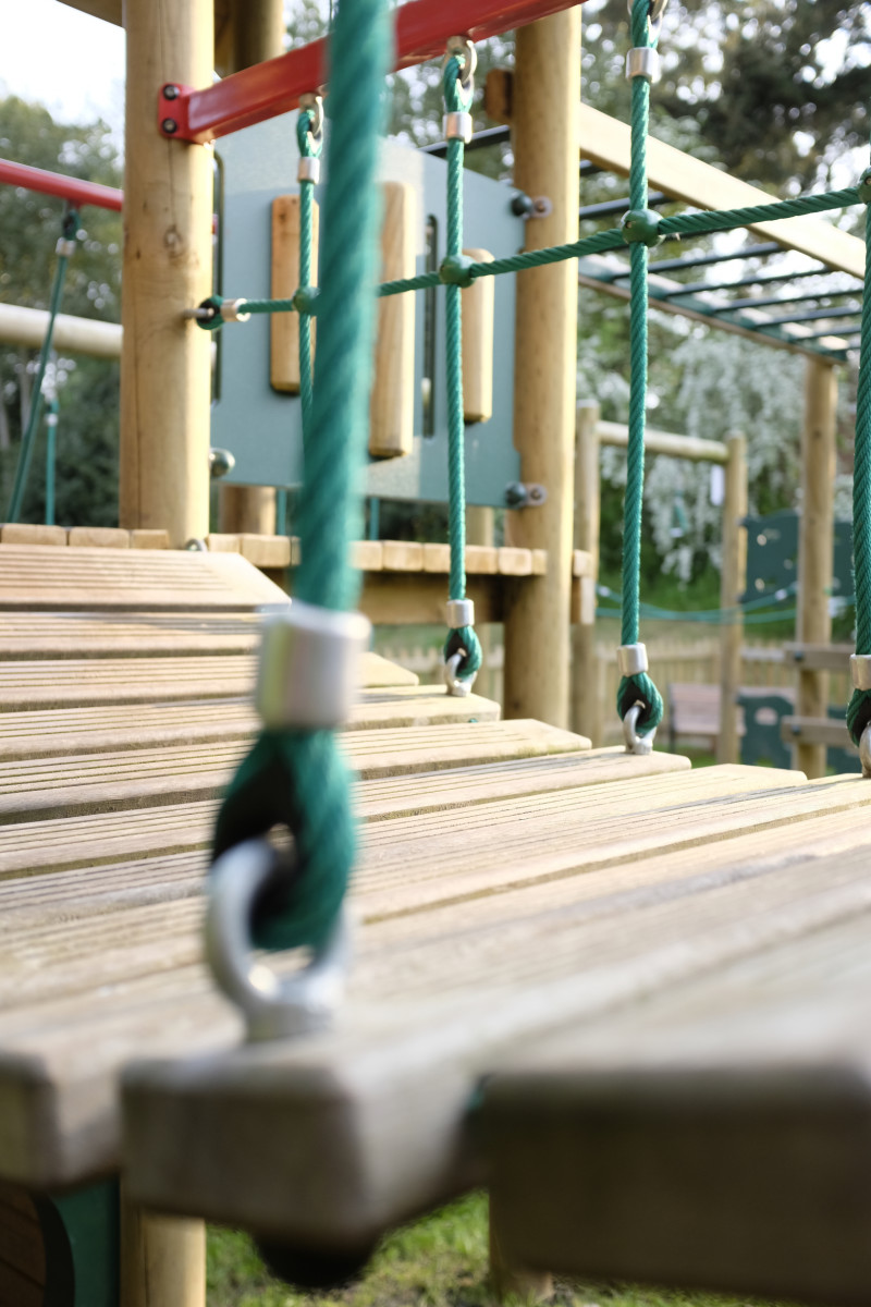 A close-up of the wooden bridge on the activity tower