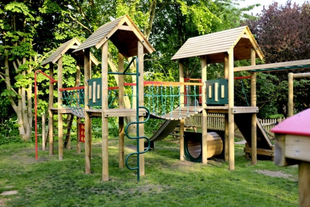 A view of the wooden activity centre and climbing frame
