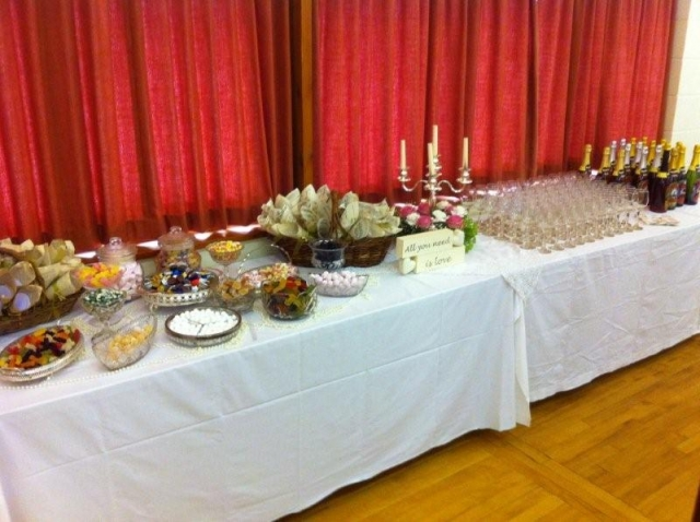 Tables decorated and loaded with food for a wedding