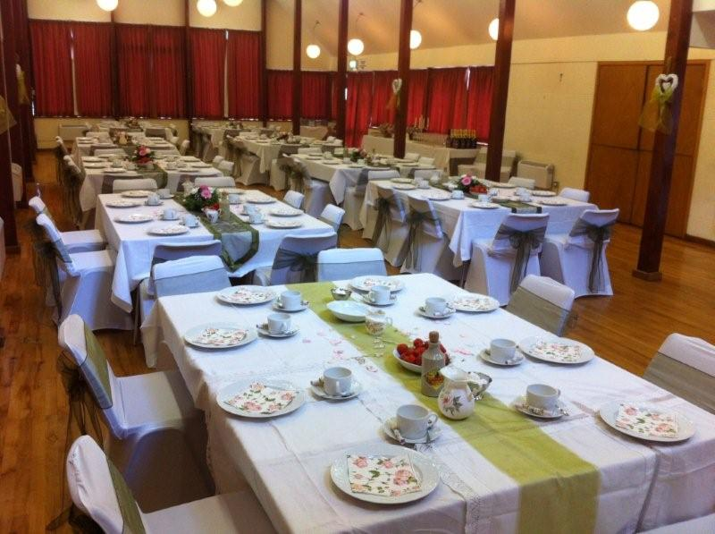 The main village hall set out for a wedding party.