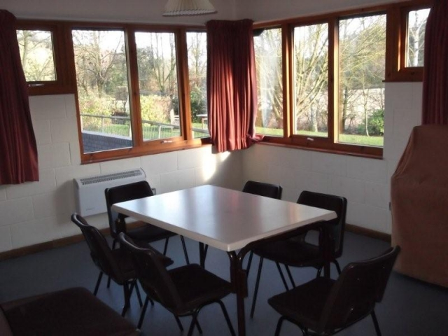 Side meeting room with table and chairs